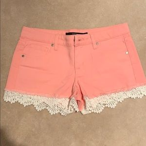 Pink denim shorts with lace detail